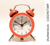a red alarm clock isolated over ... | Shutterstock . vector #1102407389