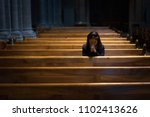 a christian girl is sitting and ... | Shutterstock . vector #1102413626