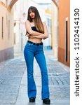 beautiful young woman posing in ...   Shutterstock . vector #1102414130