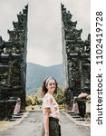 Small photo of Young and cheerful tourist enjoying the island of Bali in Indonesia. Knowing ancient Hindu temples, very spiritual places. Travel Photography. Lifestyle.