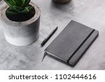 Stock photo homemade concrete pot with succulent and notebook on marble background 1102444616