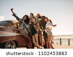 diverse friends on road trip... | Shutterstock . vector #1102453883