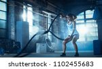 athletic female in a gym... | Shutterstock . vector #1102455683