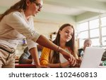 teacher helping student in... | Shutterstock . vector #1102460813