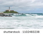 Small photo of Farol da Barra (Barra Lighthouse) in a cloudy day, Salvador, Bahia, Brazil