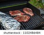 t bone steak on gas grill... | Shutterstock . vector #1102486484