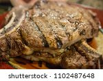 grilled t bone steak cooked on... | Shutterstock . vector #1102487648
