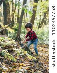 Small photo of boy in the woods. boy in the woods. boy with an ax. children in the nature. stylish boy. children's clothing