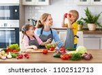 mother with children preparing... | Shutterstock . vector #1102512713