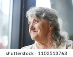 thoughtful and looking... | Shutterstock . vector #1102513763