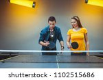 friends playing ping pong | Shutterstock . vector #1102515686