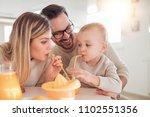 family making orange juice... | Shutterstock . vector #1102551356