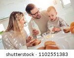cheerful young family having... | Shutterstock . vector #1102551383