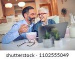 couple having breakfast while... | Shutterstock . vector #1102555049