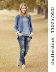 Young fashion girl at autumn outdoor. - stock photo
