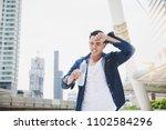 attractive handsome asian man... | Shutterstock . vector #1102584296