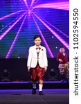 """Small photo of Udonthani, Thailand ; May 27, 2018 - Kids Children walk as Fashion Show on Final Stage at Central Hall for """"Mister Star Thailand 2018 E-sarn"""""""