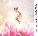 Blond Girl Jumping into a Giant Flower - stock photo