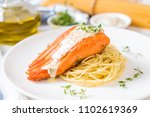 spaghetti with fried salmon on... | Shutterstock . vector #1102619369