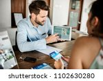guest booking a tour at a hotel | Shutterstock . vector #1102630280