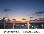 sunrise on a beach. | Shutterstock . vector #1102633223