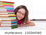 Young student with lots of books - happy and smiling - stock photo