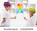One for all and all for a tidy room - kids with duster brushes, focus on the girl - stock photo