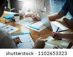 business team discussing and... | Shutterstock . vector #1102653323