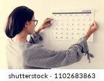 woman checking the calendar | Shutterstock . vector #1102683863