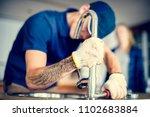 plumber fixing kitchen sink   Shutterstock . vector #1102683884