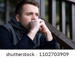 Sad Caucasian Man Sitting Alon...
