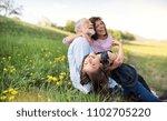 senior couple with grandaughter ... | Shutterstock . vector #1102705220