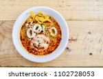 noodle tom yum sea food on wood ... | Shutterstock . vector #1102728053