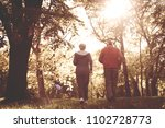 senior woman and man jogging... | Shutterstock . vector #1102728773