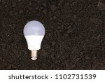 led bulb with lighting on soil... | Shutterstock . vector #1102731539