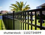 black aluminum fence  | Shutterstock . vector #1102734899
