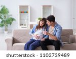 pregnant woman with husband at...   Shutterstock . vector #1102739489