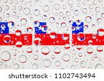 flags  of chile behind a glass... | Shutterstock . vector #1102743494