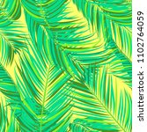 seamless pattern of palm leaves.... | Shutterstock .eps vector #1102764059