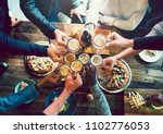 friends toasting with craft beer | Shutterstock . vector #1102776053