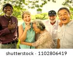 senior friends having fun at... | Shutterstock . vector #1102806419