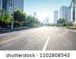 asphalt road in morden city | Shutterstock . vector #1102808543