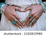 closeup of young woman hands in ... | Shutterstock . vector #1102815980