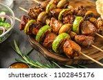 barbecue skewers with juicy... | Shutterstock . vector #1102845176