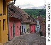 medieval alley in sighisoara... | Shutterstock . vector #1102877258