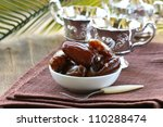 sweet dates in  bowl on a natural background - stock photo