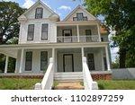 historic farmhouse home | Shutterstock . vector #1102897259
