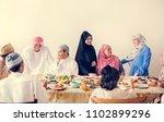muslim family having a ramadan... | Shutterstock . vector #1102899296