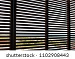 wooden closed shutters on the... | Shutterstock . vector #1102908443