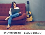 woman freelancer working with... | Shutterstock . vector #1102910630